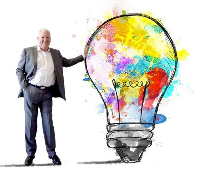 A man in suite holding a lightbulb